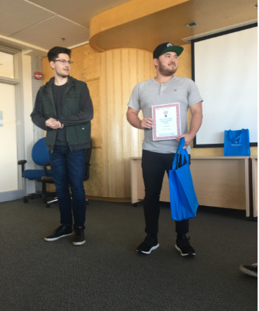 """John Meszaros received one of the 2019 Cole Schisler """"I give a DAMN award"""" for his project Give Girls a Choice. Cole Schisler is on the left."""